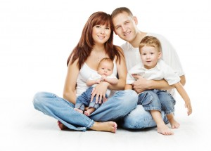 Young family four persons, smiling father mother and two childre