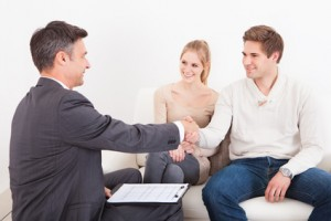 Consultant Shaking Hand With Customer
